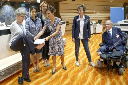 Theresia Degener, chairperson of the UN Committee on the Rights of Persons with Disabilities (CRPD), receives an alternative report of Inclusion Handicap by the President of Inclusion Handicap Pascale Bruderer Wyss (C) past Former Swiss Federal President Micheline Calmy-Rey, 2nd right, and Christian Lohr, right, member of the Swiss National Council, prior the 18th session of CRPD, at the European headquarters of the United Nations in Geneva, Switzerland, 29 August 2017.