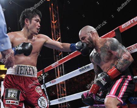 (L-R) Yoshihiro Kamegai (JPN), Miguel Cotto (PUR)