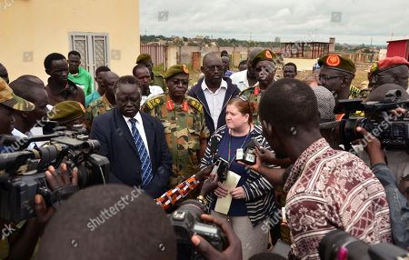 U.S. Consul Denise Knapp, center, speaks to the media, accompanied by South Sudanese army officials and ministry of foreign affairs representatives, after the body of killed American journalist Christopher Allen was officially handed over to the U.S. embassy, at a mortuary in the capital Juba, South Sudan . The 28-year-old freelance journalist was killed Saturday amid fighting between government and rebel forces near the Ugandan border