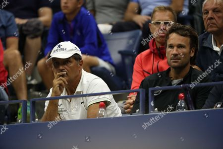 Uncle Toni Nadal and coach Carlos Moya are watching Spanish tennis player Rafael Nadal in action during his match in the 1st round