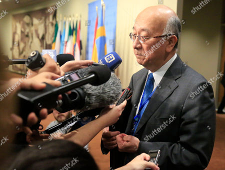 Japan's United Nations Ambassador Koro Bessho speak with reporters before attending U.N. Security Council consultations on North Korea, at U.N. headquarters
