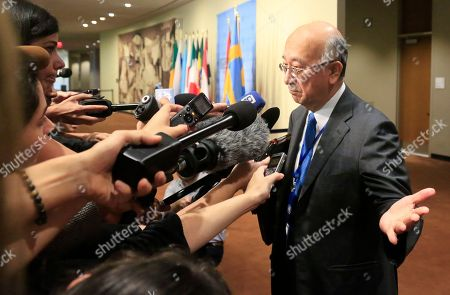 Japan's United Nations Ambassador Koro Bessho speak with reporters before attending U.N. Security Council closed consultations on North Korea, at U.N. headquarters