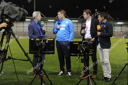 AFC Fylde managerÊDave Challinor chats with BT Sports presenter Matt Smith and pundits Grant Holt & Dean Saunders during AFC Fylde vs Barrow, Vanarama National League Football at Mill Farm on 28th August 2017