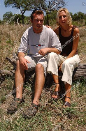 Stock Picture of Julie Stevens Who Was Kidnapped And Raped By A Gang Of Men In South Africa Julie Was Travelling To A Local Beauty Spot At Long Tom Pass With Her Boyfriend Tinus Opperman When The Gang Struck. Picture Shows Julie Still In South Africa After Enduring 14 Hours Of Horrific Crime Inflicted On Her And Her Friend Tinus. Julie Helps Tinus Who Suffered A Stab Wound In His Leg And Cuts To His Back In A Car Crash.  22/11/02.