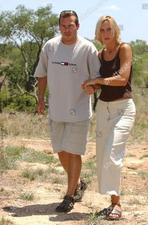 Julie Stevens Who Was Kidnapped And Raped By A Gang Of Men In South Africa Julie Was Travelling To A Local Beauty Spot At Long Tom Pass With Her Boyfriend Tinus Opperman When The Gang Struck. Picture Shows Julie Helping Tinus Who Suffered A Stab Wound In His Leg And Cuts To His Back In A Car Crash.  22/11/02.