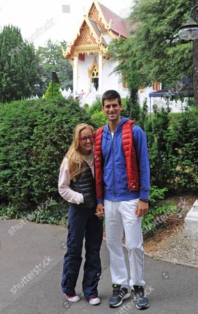 Novak Djokovic And His Girlfriend Jelena Ristic At The Buddhapadipa Temple In Wimbledon Where They Both Went To Meditate Before Thursday's Game Against Bobby Reynolds. .