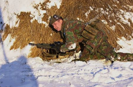Sgt. Tony Moore Leading A Patrol Of Soldiers From The Highlanders Checks A Haystack During A Search For Hidden Weapons In Northern Kosovo. .