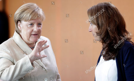 German Chancellor Angela Merkel, left, talks to Aydan Ozoguz, right, Minister of State in the Federal Chancellery and Federal Government Commissioner for Migration, Refugees and Integration, prior to the weekly cabinet meeting at the chancellery in Berlin, Germany