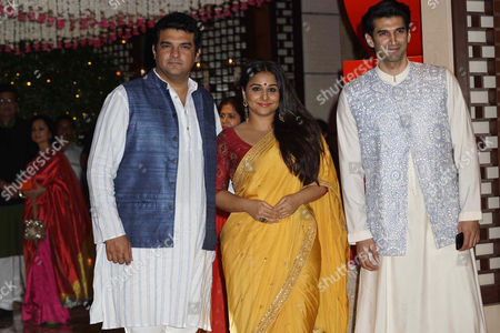 Bollywood actor Vidya Balan with husband Siddharth Roy Kapur and brother-in-law and actor Aditya Roy Kapur during the Ganesh Puja hosted by Mukesh Ambani, the chairman of Reliance Industries Ltd (RIL), at his residence to celebrate Ganesh Chaturthi, at Antilia, Mumbai on August 25, 2017, In Mumbai, India. (Photo by Prodip Guha/Hindustan Times)