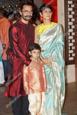 Bollywood actor Aamir Khan with his wife Kiran Rao and son Azad during the Ganesh Puja hosted by Mukesh Ambani, the chairman of Reliance Industries Ltd (RIL), at his residence to celebrate Ganesh Chaturthi, at Antilia, Mumbai on August 25, 2017, In Mumbai, India. (Photo by Prodip Guha/Hindustan Times)