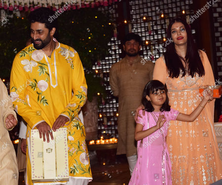 Bollywood actors Aishwarya and Abhishek Bachchan with daughter Aaradhya during the Ganesh Puja hosted by Mukesh Ambani, the chairman of Reliance Industries Ltd (RIL), at his residence to celebrate Ganesh Chaturthi, at Antilia, Mumbai on August 25, 2017, In Mumbai, India. (Photo by Prodip Guha/Hindustan Times)