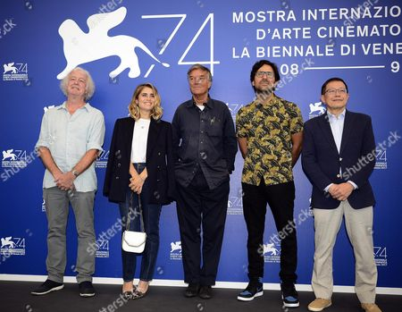 Members of the 'Opera Prima - Luigi De Laurentiis' jury (L-R) Albert Lee, Greta Scarano, Benoit Jacquot, Yorgos Zois and Geoff Andrew pose during a photocall at the 74th annual Venice International Film Festival, in Venice, Italy, 30 August 2017. The festival runs from 30 August to 09 September.