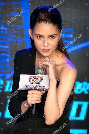 Leo Wu, Hannah Quinlivan, Orlando Bloom, Jing Liang, Simon Yam, Tom Price Australian-Taiwanese actress Hannah Quinlivan poses for a photo during a press conference for the movie S.M.A.R.T. Chase in Beijing, . The film opens in theaters Sept. 30