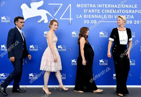 (L-R) Italian actor Thomas Trabacchi, Romanian actress Anamaria Marinca, British actress Karina Fernandez, and  Danish actress Trine Dyrholm pose during a photocall for 'Nico, 1988' at the 74th annual Venice International Film Festival, in Venice, Italy, 30 August 2017. The movie is presented in the Orizzonti section at the festival running from 30 August to 09 September.