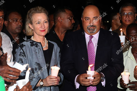US Assistant Secretary of State for South and Central Asian Affairs and Acting Special Representative for Afghanistan and Pakistan Alice Wells (L) and Ambassador to Sri Lanka Atul Keshap (R) hold up candles with family members of disappeared during the civil war with the Liberation Tigers of Tamil Eelam (LTTE) to commemorate the international day of the disappeared in Colombo, Sri Lanka