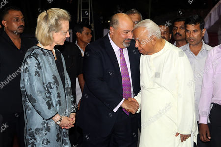 Ambassador to Sri Lanka Atul Keshap (C) talks with the opposition leader Rajavarothiam Sampanthan (R) as US Assistant Secretary of State for South and Central Asian Affairs and Acting Special Representative for Afghanistan and Pakistan Alice Wells (L) looks on during a commemorate the international day of the disappeared event in Colombo, Sri Lanka
