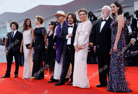 Members of the jury of the 74th edition of the Venice Film Festival, from left, Michel Franco, Anna Mouglalis, Annette Bening, Ildiko Enyedi, Yonfan, Edgar Wright, Jasmine Trinca, David Stratton and Rebecca Hall pose on the red carpet, at Venice Lido, Italy