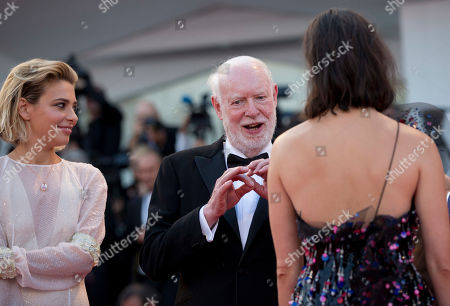 """David Stratton, Rebecca Hall, Jasmine Trinca Jury members David Stratton, center, Rebecca Hall, and Jasmine Trinca, left, talk as they arrive on the red carpet of the premiere of the film """"Downsizing"""" which opens the 74th edition of the Venice Film Festival in Venice"""