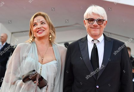 Italian director Ricky Tognazzi (R) and his wife Simona Izzo arrive for the opening ceremony and screening of 'Downsizing' at the 74th annual Venice International Film Festival, in Venice, Italy, 30 August 2017. The festival runs from 30 August to 09 September.