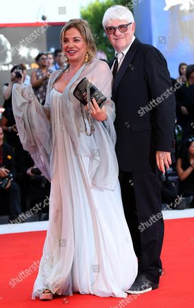 Member of the 'Venice VR' jury Italian director Ricky Tognazzi with his wife Simona Izzo (R) arrive for the opening ceremony and screening of 'Downsizing' at the 74th annual Venice International Film Festival, in Venice, Italy, 30 August 2017.  The festival runs from 30 August to 09 September.