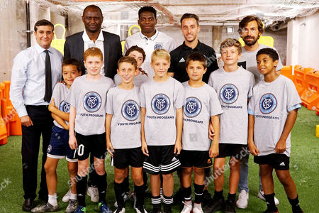 Jon Patricof, Patrick Vieira, Sean Johnson, RJ Allen, Andrea Pirlo with NYCFC youth players