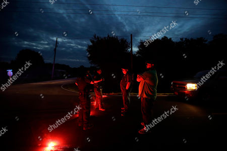 Two men talk with officers at a roadblock less than three miles from the Arkema Inc. chemical plant, in Crosby, Texas. A The Houston-area chemical plant that lost power after Harvey engulfed the area in extensive floods was rocked by multiple explosions early Thursday, the plant's operator said. The Arkema Inc. plant had been left without refrigeration for chemicals that become volatile as the temperature rises