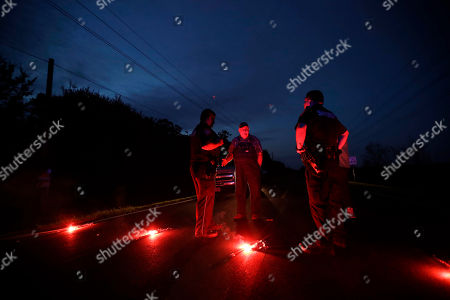 A man talks with officers at a roadblock less than three miles from the Arkema Inc. chemical plant, in Crosby, Texas. The Houston-area chemical plant that lost power after Harvey engulfed the area in extensive floods was rocked by multiple explosions early Thursday, the plant's operator said. The Arkema Inc. plant had been left without refrigeration for chemicals that become volatile as the temperature rises