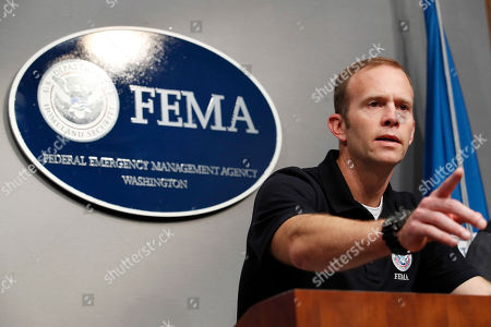 Brock Long, Roy Wright, Alex Amparo Federal Emergency Management Agency (FEMA) Administrator Brock Long speaks during a news conference in Washington, about Harvey's devastating flooding