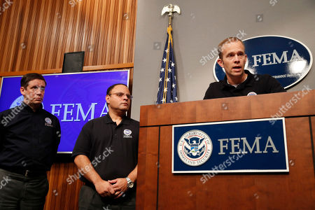 Brock Long, Roy Wright, Alex Amparo Federal Emergency Management Agency (FEMA) Administrator Brock Long, right, speaks during a news conference in Washington, about Harvey's devastating flooding. At far left is Deputy Associate Administrator for Insurance and Mitigation Roy Wright, with Alex Amparo, assistant administrator for recovery