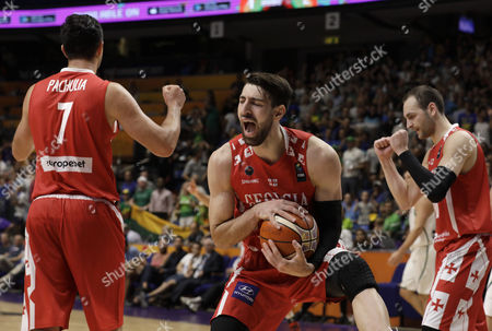 Tomike Shengelia (C) of Georgia holds the ball and jubilates with teammates Zaza Pachulia (L) and Duda Sanadze during the EuroBasket 2017 group B match between Lithuania and Georgia, in Tel Aviv, Israel, 31 August 2017.
