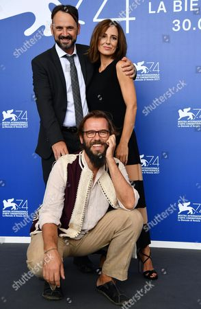 Italian actors Valentina Carnelutti (R) and Paolo Pierobon (L) with Italian director Andrea Segre pose during a photocall for 'L'Ordine delle Cose'' at the 74th annual Venice International Film Festival, in Venice, Italy, 31 August 2017. The movie is presented in the 'Proiezioni Speciali' section at the festival running from 30 August to 09 September.