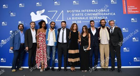 (L-R) Actors Giuseppe Battiston, Olivier Rabourdin, Yusra Warama, Khalifa Abo Khraisse, Paolo Pierobon, Valentina Carnelutti, Greta Galie', Riccardo Macchion, Italian director Andrea Segre, and actor Fabrizio Ferracane pose during a photocall for 'L'Ordine delle Cose'' at the 74th annual Venice International Film Festival, in Venice, Italy, 31 August 2017. The movie is presented in the 'Proiezioni Speciali' section at the festival running from 30 August to 09 September.