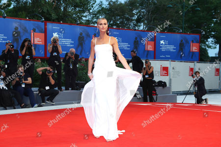 Model Renata Kuerten poses for photographers upon arrival at the premiere of the film 'The Shape of Water' during the 74th edition of the Venice Film Festival in Venice, Italy
