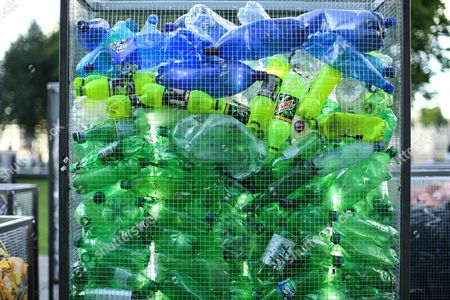 Bottles in a container that forms part of the Future Dust art installation by Maria Arceo.