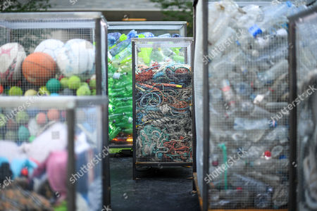 Containers of rubbish that form part of the Future Dust art installation by Maria Arceo.