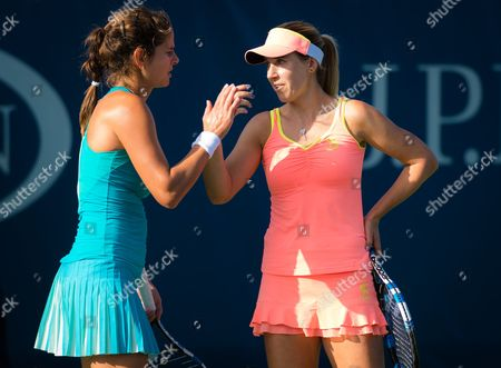 Julia Goerges of Germany and Olga Savchuk of the Ukraine during their first-round doubles match