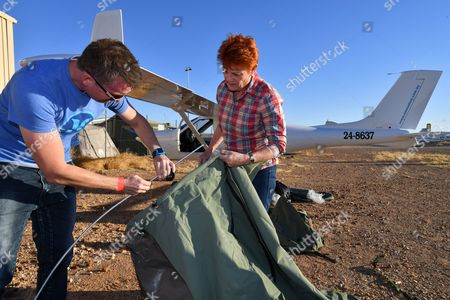One Nation leader, Senator Pauline Hanson (R) and her political advisor James Ashby (L) set up camp next to the light plane which they travelled in,  Birdsville,  Australia, 31 August 2017. Birdsville is situated on the edge of the Simpson Desert, 1590 kms from Brisbane and its normal population of 115 people swells to a crowd of more than 6000 for its annual horse race.