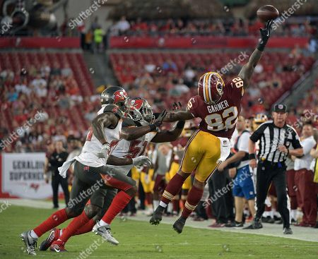 Stock Picture of Kendell Beckwith, Ryan Smith, Manasseh Garner Washington Redskins tight end Manasseh Garner (82) can't make the catch on a pass by Nate Sudfeld after getting past Tampa Bay Buccaneers cornerback Ryan Smith (29) and inside linebacker Kendell Beckwith (51) during the first quarter of an NFL preseason football game, in Tampa, Fla