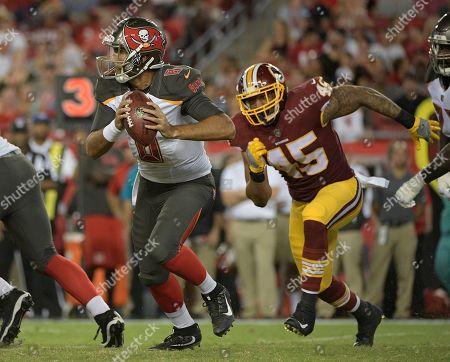 Pete Robertson, Sefo Liufau, A.J. Francis Tampa Bay Buccaneers quarterback Sefo Liufau (8) runs away from Washington Redskins linebacker Pete Robertson (45) during the second quarter of an NFL preseason football game, in Tampa, Fla