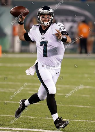 Philadelphia Eagles quarterback Dane Evans prepares to make a touchdown pass to wide receiver Marcus Johnson during the second half of an NFL football game against the New York Jets, in East Rutherford, N.J