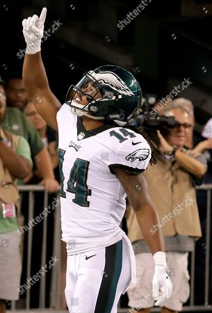Philadelphia Eagles wide receiver Marcus Johnson celebrates after catching a touchdown pass from quarterback Dane Evans during the second half of an NFL football game against the New York Jets, in East Rutherford, N.J