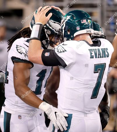 Dane Evans, Marcus Johnson Philadelphia Eagles quarterback Dane Evans, right, celebrates with wide receiver Marcus Johnson after they connected for a touchdown pass during the second half of an NFL football game against the New York Jets, in East Rutherford, N.J