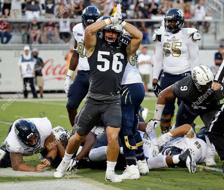 Central Florida linebacker Pat Jasinski (56) signals a safety against Florida International after running back Alex Gardner was stopped in the end zone by the Central Florida defense during the first half of an NCAA college football game, in Orlando, Fla