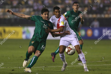 Peru's Paolo Hurtado, right, and Bolivia's Ronald Raldes vie for the ball during a 2018 World Cup qualifying soccer match in Lima, Peru