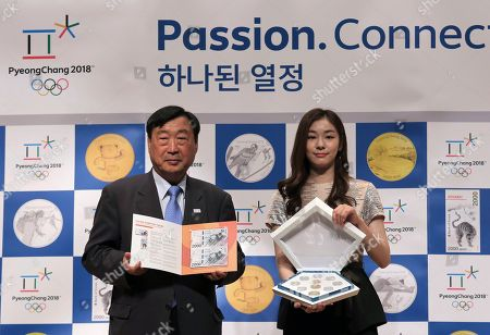 Yuna Kim, Lee Hee-beom Former South Korean Olympic figure skating champion Yuna Kim, right, who is an honorary ambassador for the 2018 Winter Olympics, and Lee Hee-beom. president of the Pyeongchang Organizing Committee for the 2018 Olympic and Paralympic Winter Games, pose with the commemorative coins and bank notes for the winter games during the launching ceremony in Seoul, South Korea, . South Korea's Pyeongchang will host the Winter Olympics which will start in February 2018