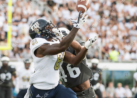 Orlando, FL, U.S: FIU Panthers wide receiver Thomas Owens (81) makes a catch while being defended by UCF Knights defensive back Chris Johnson (46) during NCAA football game between FIU Golden Panthers and the UCF Knights at Spectrum Stadium in Orlando, Fl