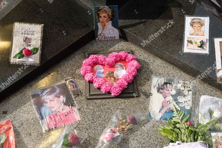 People pay tribute to the late Princess Diana above the Post de l'Alma tunnel in Paris.  Princess Diana died with Dodi Al-Fayed in a car crash on 31st August 1997.