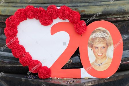 People pay tribute to the late Princess Diana above the Post de l?Alma tunnel in Paris.  Princess Diana died with Dodi Al-Fayed in a car crash on 31st August 1997.