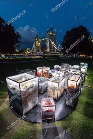 The installation, 'Future Dust' by Maria Arceo is illuminated at night in front of Tower Bridge on the River Thames