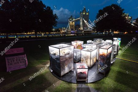 Stock Photo of The installation, 'Future Dust' by Maria Arceo is illuminated at night in front of Tower Bridge on the River Thames